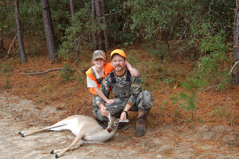 Click to view full size image  ==============  Me & my daugther My daughter's first deer.